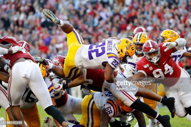 Clyde Edwards-Helaire of the LSU Tigers dives for a 1-yard touchdown during the second quarter against the Alabama Crimson Tide in the game at...