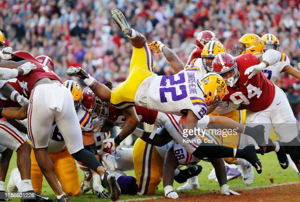 Clyde EdwardsHelaire of the LSU Tigers dives for a 1yard touchdown during the second quarter against the Alabama Crimson Tide in the game at...
