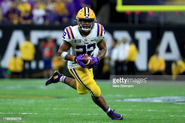 Clyde EdwardsHelaire of the LSU Tigers runs the ball against the Clemson Tigers during the fourth quarter in the College Football Playoff National...