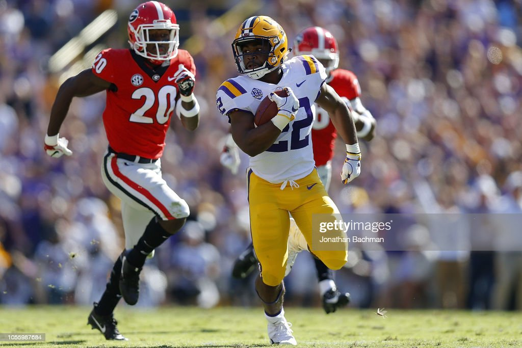 Clyde Edwards-Helaire of the LSU Tigers runs with the ball as J.R. ... 9005569fe
