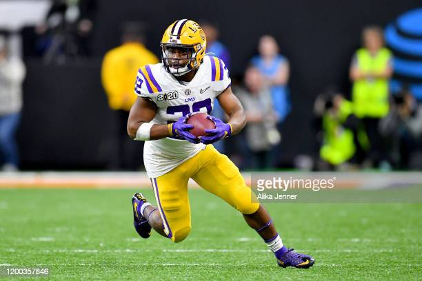 Clyde EdwardsHelaire of the LSU Tigers runs with the ball during the fourth quarter of the College Football Playoff National Championship game...