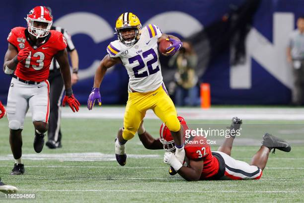 Clyde EdwardsHelaire of the LSU Tigers runs with the ball in the second half against the Georgia Bulldogs during the SEC Championship game at...