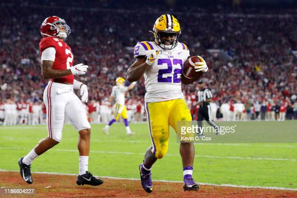 Clyde EdwardsHelaire of the LSU Tigers rushes for a 5yard touchdown during the fourth quarter against the Alabama Crimson Tide in the game at...