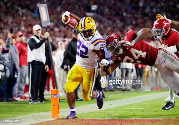 Clyde EdwardsHelaire of the LSU Tigers rushes for a 7yard touchdown during the fourth quarter against the Alabama Crimson Tide in the game at...
