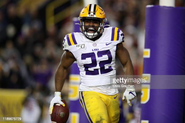 Clyde EdwardsHelaire of the LSU Tigers scores a touchdown against the Arkansas Razorbacks at Tiger Stadium on November 23 2019 in Baton Rouge...