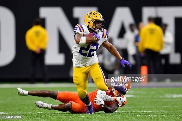 Clyde EdwardsHelaire of the LSU Tigers spins out of a tackle from Derion Kendrick of the Clemson Tigers during the fourth quarter of the College...