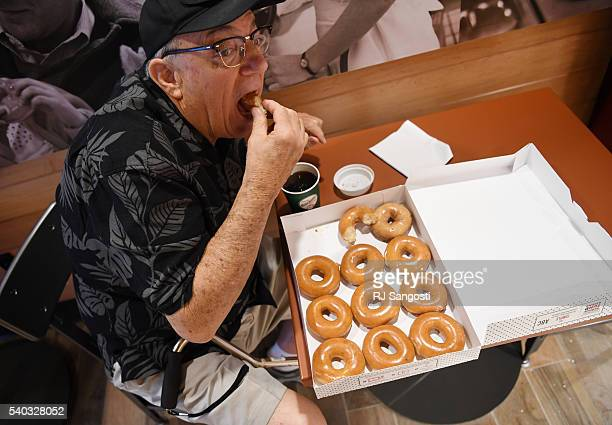Clyde Lay sits down with a dozen donuts at the new Krispy Kreme on the16th Street Mall in Denver, June 15, 2016. Lay said, some of the donuts he was...
