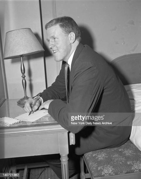 Clyde Lovellette University of Kansas athlete catches up with his correspondence at the Hotel Paramount at 235 W 46 St