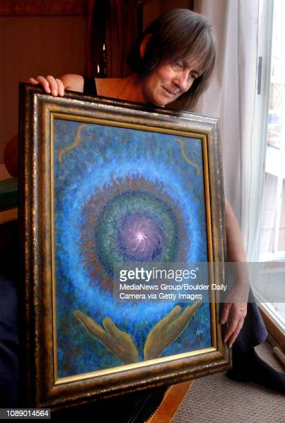 Clyde Rae Ashe holds a painting she calls Healing Hands which was painted by her husband Steve in 1997 shortly before he was diagnosed with and died...