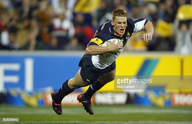 Clyde Rathbone of the Brumbies dives in for the try during the Super 12 semi final between the ACT Brumbies and the Chiefs at Canberra Stadium May...