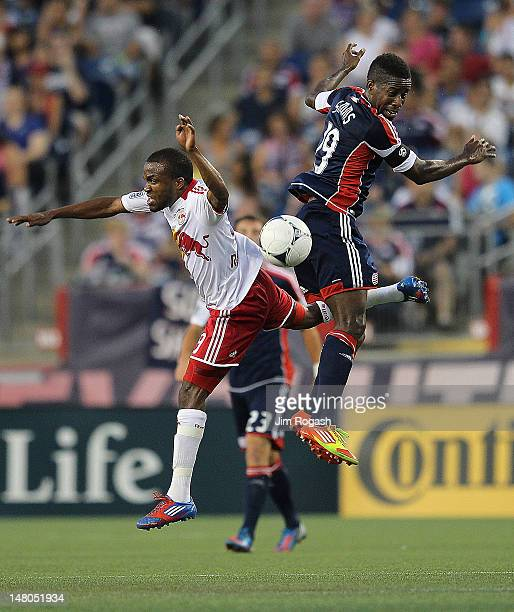 Clyde Simms of the New England Revolution battles Dane Richards of the New York Red Bulls for control of the ball in the second half at Gillette...