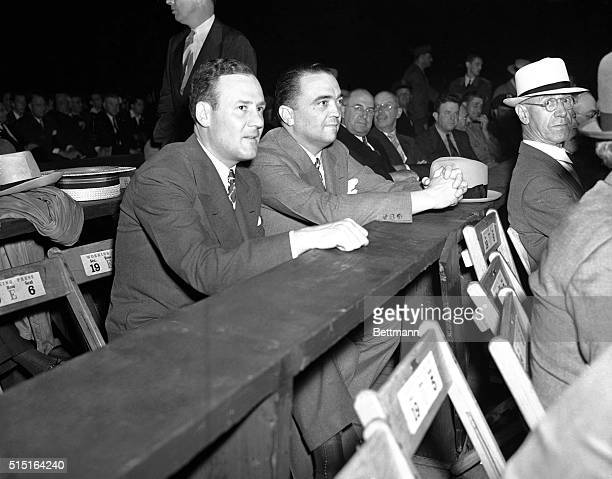 Clyde Tolson of the Department of Justice, and chief G-Man, J. Edgar Hoover, as they attended the Louis-Galento title fight at the Yankee Stadium,...