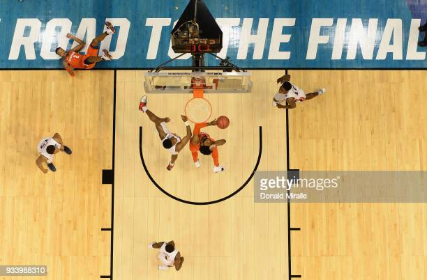 Clyde Trapp of the Clemson Tigers shoots against Chuma Okeke of the Auburn Tigers in the second half during the second round of the 2018 NCAA Men's...