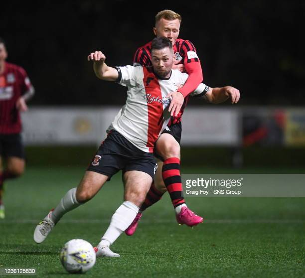 Clydebank's Adam Hodge and Elgon's Connor O'Keefe during a Scottish Cup second round match between Clydebank and Elgin City at Holm Park, on October...