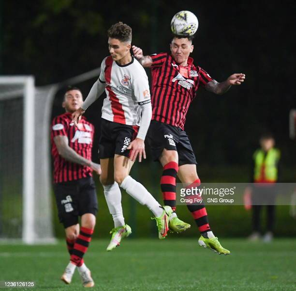 Clydebank's Hamish McKinlay and Elgin's Archie McPhee during a Scottish Cup second round match between Clydebank and Elgin City at Holm Park, on...