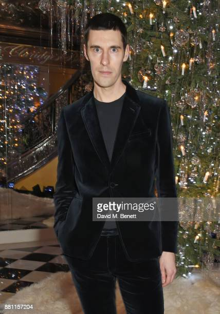 Clym Evernden attends Claridge's Christmas Tree Party 2017 designed by Karl Lagerfeld on November 28 2017 in London United Kingdom