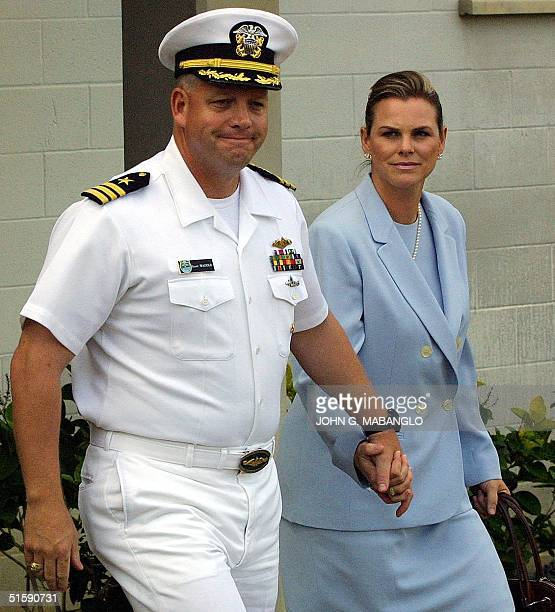 Cmdr Scott D Waddle former commanding officer of the nuclear attack submarine USS Greeneville leaves with his wife Jill from the Naval Legal Service...