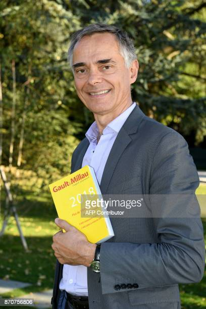 Côme de Chérisey Chairman of the Gault Millau guide poses near the restaurant 'L'Auberge du Pere Bise' in Talloires in the French Alps on October 12...