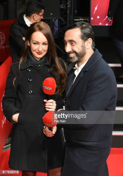 Cnews reporters Virginie ChomickiÊand Olivier Benkemoun attend Christmas Lights Launch On The Champs Elysees on November 22 2017 in Paris France