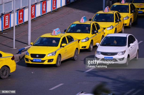 CNGfueled taxis line up outside a gas station in southwest China's Chongqing Municipality Wednesday Jan 10 2018 Many provinces have encountered...