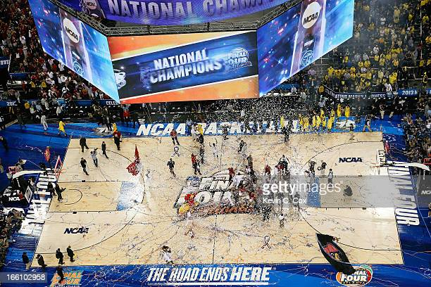 Cnnfetti falls as the Louisville Cardinals celebrate their 8276 win against the Michigan Wolverines during the 2013 NCAA Men's Final Four...