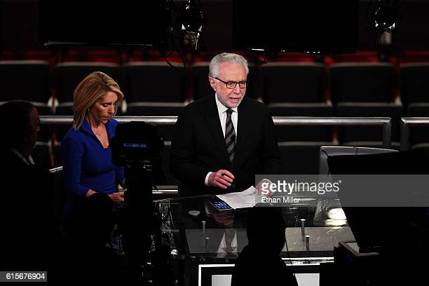 Cnn's Dana Bash and Wolf Blitzer report in a temporary auditorium balcony television studio before the start of the third U.S. Presidential debate...