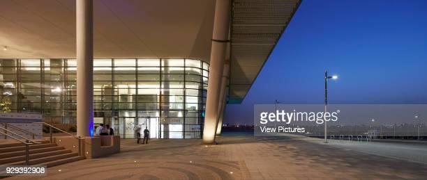 Cnopied entrance courtyard at dusk. Siemens Masdar, Abu Dhabi, United Arab Emirates. Architect: Sheppard Robson, 2014.