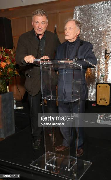 Co Chair of the Hamptons International Film Festival Alec Baldwin and honoree Dick Cavett speak during the Opening Night Party during Hamptons...