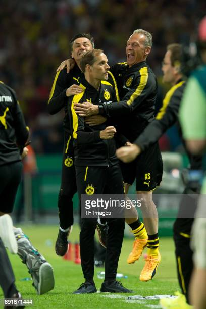 Co coach Arno Michels of Dortmund Head coach Thomas Tuchel of Dortmund and Rainer Schrey celebrates after winning the DFB Cup final match between...