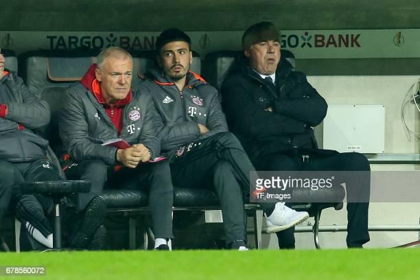 Co coach Hermann Gerland of Bayern Munich Cocoach Davide Ancelott and iHead coach Carlo Ancelotti of Bayern Munich looks on during the German Cup...