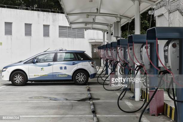 Co E6 electric taxi is charged at the company's charging station in Shenzhen China on Wednesday Sept 20 2017 China the worlds biggest auto market may...