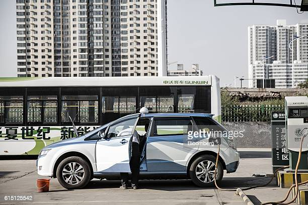 Co E6 electric taxi stands plugged to a charger at a State Grid Corp of China charging station in Taiyuan Shanxi province China on Tuesday Sept 13...