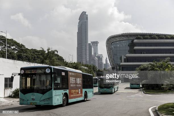BYD Co electric buses drive out of a public transportation hub in Shenzhen China on Wednesday Sept 20 2017 China the worlds biggest auto market may...
