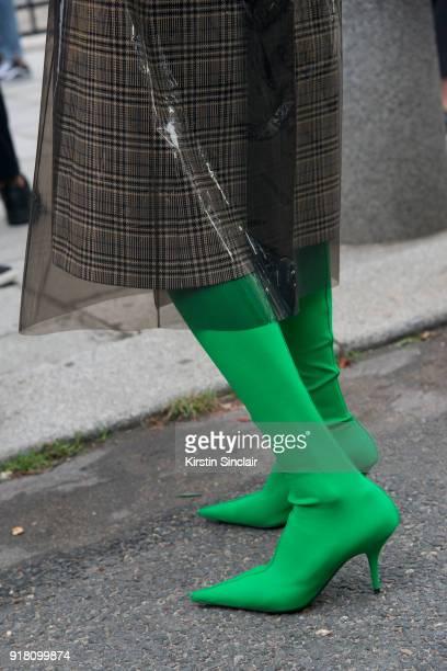 2b3962c275130 Co founder of clothing and jewellery brand Masterpeace Irina Linovich wears  Balenciaga boots Calvin Klein coat