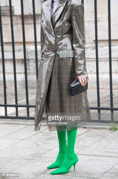 6a5275a4fdecf Co founder of clothing and jewellery brand Masterpeace Irina Linovich wears  Balenciaga boots and bag Calvin