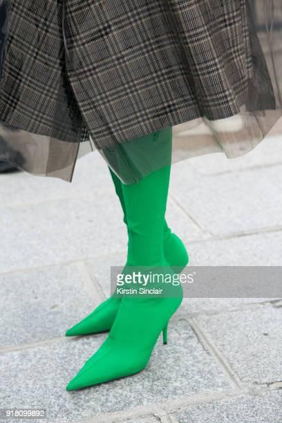 85a0b5e4e9e78 Co founder of clothing and jewellery brand Masterpeace Irina Linovich wears  Balenciaga boots and a Calvin