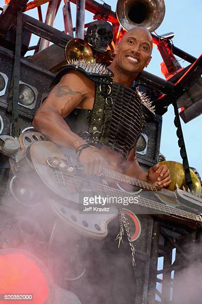 Co- host Dwayne Johnson onstage during the 2016 MTV Movie Awards at Warner Bros. Studios on April 9, 2016 in Burbank, California. MTV Movie Awards...