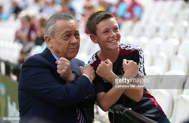 Co owner of West Ham United David Sullivan poses for a picture with a fan before the Premier League match between West Ham United and AFC Bournemouth...