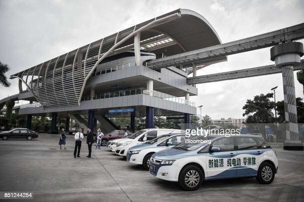 Co SkyRail monorail train stands at a station top as vehicles stand at the company's headquarters in Shenzhen China on Thursday Sept 21 2017 China...