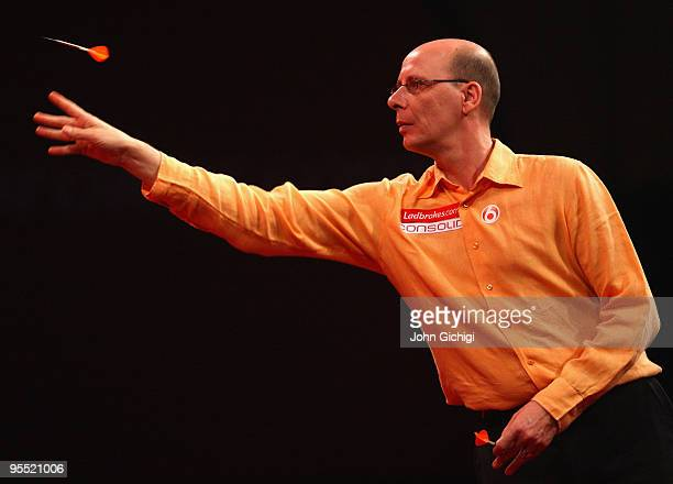 Co Stompe of Netherlands in action against Mark Webster of Wales during the Quarter Finals of the 2010 Ladbrokescom World Darts Championships at...