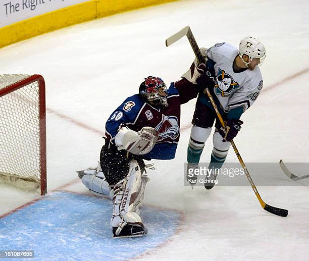 5_9_06___DENVER CO_____Av goalie Jose theodore hits Mighty Duck Andy McDonald in the 1st period of Game 3 between the Colorado Avalanche and the...