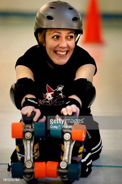MARCH 16 2005 THORNTON CO_Hermione Danger has un unsuspecting smile while stretching out before practice with the Rocky Mountain RollerGirls at the...