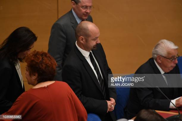 Coaccused Vincent Crase a security agent employed by the French President's centrist La Republique en Marche party arrive to his seat next to...