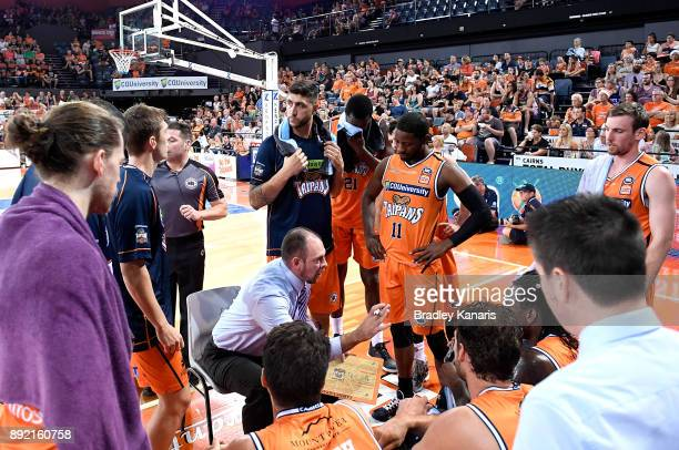Coach Aaron Fearne of the Taipans talks tactics to his players at a time out during the round 10 NBL match between the Cairns Taipans and the...