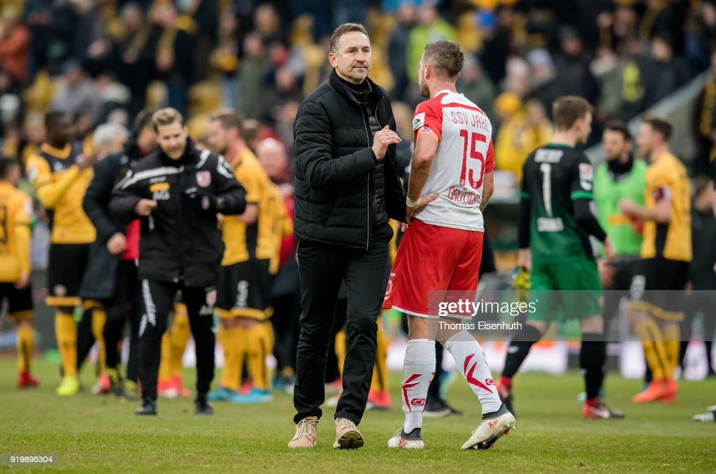 Coach Achim Beierlorzer (L) and Marco Gruettner of Regensburg react after the Second Bundesliga match between SG Dynamo Dresden and SSV Jahn Regensburg at DDV-Stadion on February 18, 2018 in Dresden, Germany.