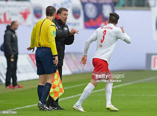 Coach Achim Beierlorzer of RB Leipzig gives instructions to Anthony Jung of RB Leipzig during the game between RB Leipzig and 1 FC Union Berlin on...