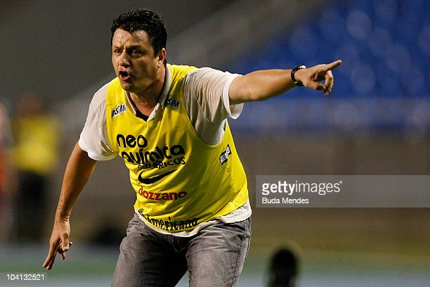Coach Adilson Batista of Corinthians reacts during a match against Fluminense as part of Brazilian Championship at Engenhao Stadium on September 15...