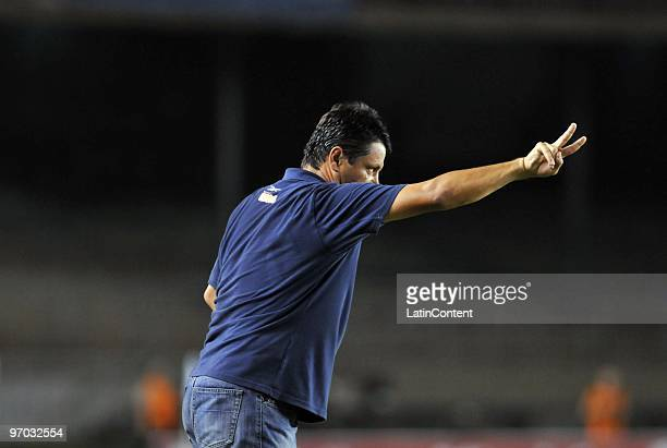 Coach Adilson Batista of Cruzeiro gestures during their soccer match against Colo Colo as part of 2010 Libertadores Cup at Minerao stadium on...