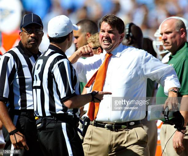 Coach Al Golden of the Miami Hurricanes argues with the officials during a game against the North Carolina Tar Heels at Kenan Stadium on October 15,...