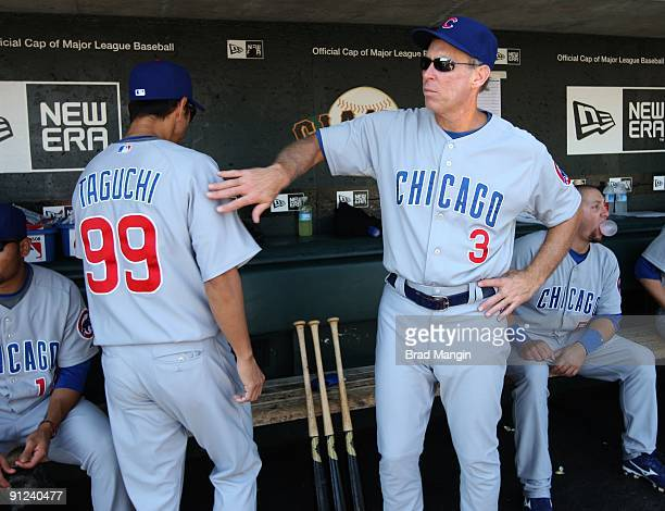 Coach Alan Trammell and So Taguchi of the Chicago Cubs get ready in the dugout before the game against the San Francisco Giants at ATT Park on...